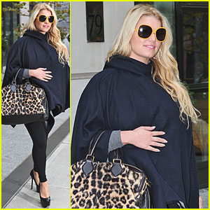 Jessica Simpson Touches Her Tummy in NYC