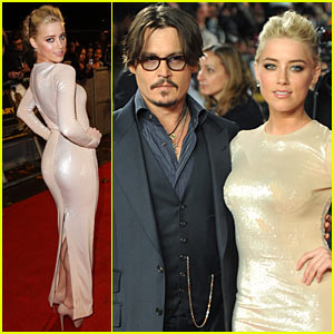 Johnny Depp wraps his arm around co-star Amber Heard at the European ...