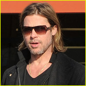 Brad Pitt Walks With A Cane