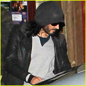 Russell Brand Leaves a London Meeting