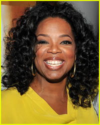 Oprah Winfrey Strains Back Lifting Birthday Flowers