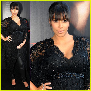 Kim Kardashian Holds Baby Bump at 'Temptation' Premiere