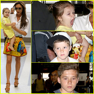 Victoria Beckham Carries Yawning Harper Through LAX!