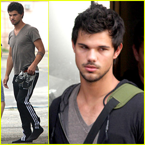 Taylor Lautner Walks in Socks on 'Tracers' Set