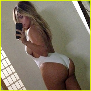 Kim Kardashian Flaunts Post Baby Body in Skimpy Swimsuit!