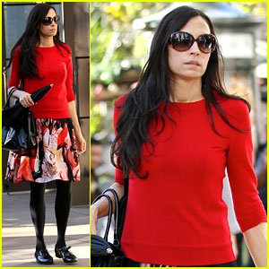 Famke Janssen is Festive in Red for Last Minute Shopping