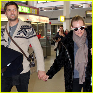 Diane Kruger & Joshua Jackson Share a Smile at Berlin Airport