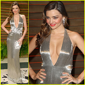 Miranda Kerr Makes Sexy Entrance with Plunging Neckline at Vanity Fair Oscars Party 2014