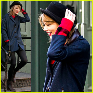 Taylor Swift Holds Onto Her Hat Before it Flies Off Her Head!