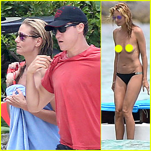 Heidi Klum Continues Topless Vacation with Boy