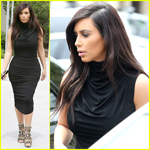 Kim Kardashian Shows Off Her Curves in Form-Fitting Dress