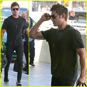 Zac Efron Checks In His Muscles at LAX