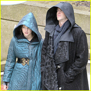 Jennifer Lawrence & Liam Hemsworth Hide Under Their Robes on Paris 'Mockingjay' Set