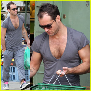 Jude Law Flaunts His Muscles in Low-Cut T-Shirt!