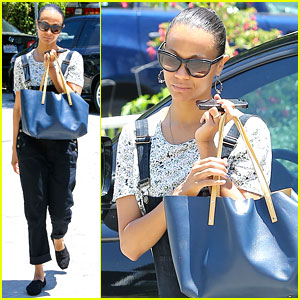 Zoe Saldana Covers Her Belly After Pregnancy Rumors Surface
