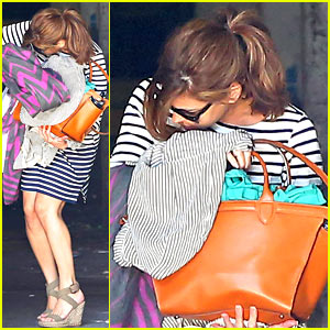 Eva Mendes Hides Baby Bump After