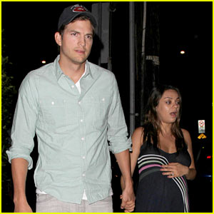 Mila Kunis Holds Onto Her Baby Bump & Ashton Kutcher's Han