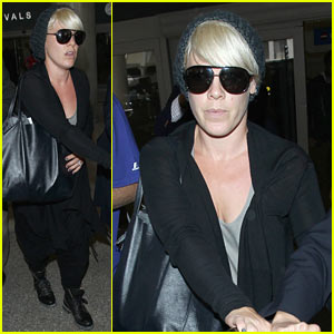 Pink Gets Some Help To Push Her Luggage Through LAX
