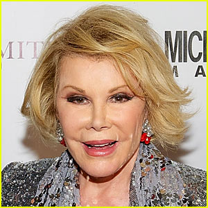 Joan Rivers Being Brought Out of Indu