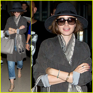 Lily Collins Returns From Paris with Fashionable Prada Bag
