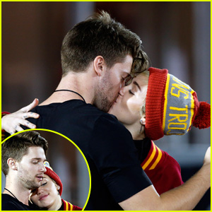 Miley Cyrus & Patrick Schwarzenegger Kiss at USC Football Game - See the Pics!
