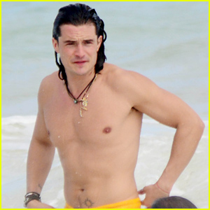 Orlando Bloom Shows Off His Soaking Wet Shirtless Body on the Beach with a Mystery Blonde!