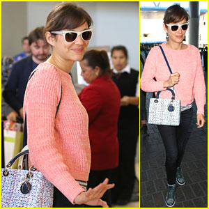 Marion Cotillard Makes a Cheerful Departure From L.A.