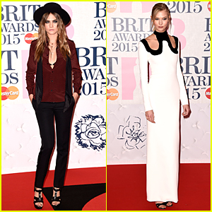Cara Delevingne Flashes Black Bra in Low Dress Shirt at BRIT Awards 2015