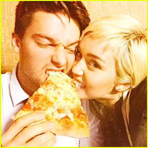 Miley Cyrus & Patrick Scharzenegger Fight Over Pizza at 'SNL 40'