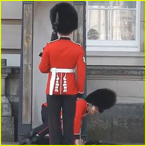 Buckingham Palace Guard Falls In Front of Tons of Tourists (Video)