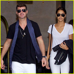 Robin Thicke & April Love Geary Wear Matching White Jeans