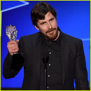 Christian Bale holds up his trophy while taking the stage at the 2016 ...