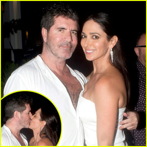 Simon Cowell Smooches Lauren Silverman for New Year's 2016