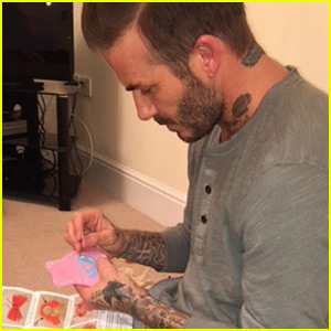 David Beckham Adorably Stitches Dress For Harper's Doll