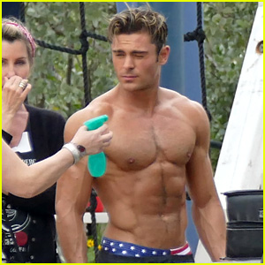 This Woman Spraying Zac Efron's Body Has Your Dream Job