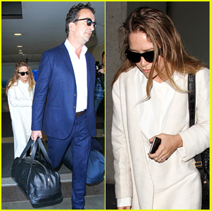 Mary-Kate Olsen Lands at LAX with Husband Olivier Sarkozy