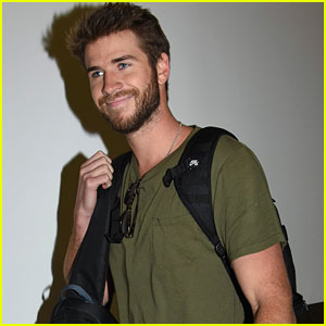 Liam Hemsworth Arrives in Sydney After 'August Man' Cover Reveal