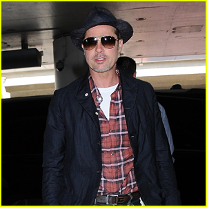 Brad Pitt Goes Plaid to Catch a Flight Out of Town