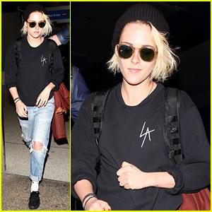 Kristen Stewart Wears Her Destination On Her Shirt at LAX