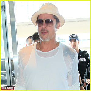 Brad Pitt Wears Sheer Top for Flight Out of Town