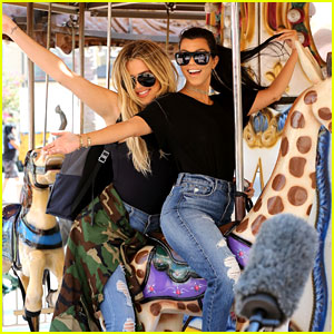 Kourtney & Khloe Kardashian Ride a Merry-Go-Round Together!