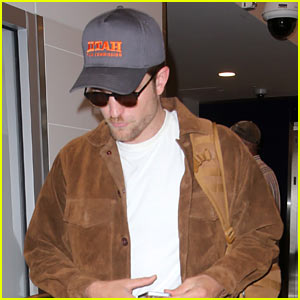 Robert Pattinson Hurries to Catch a Flight Out of LAX Airport
