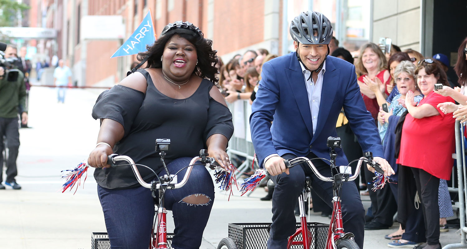gabby sidibe competes in tricycle race with harry connick