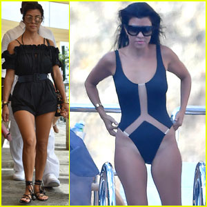 Kourtney Kardashian Goes Swimming Off a Yacht in Italy