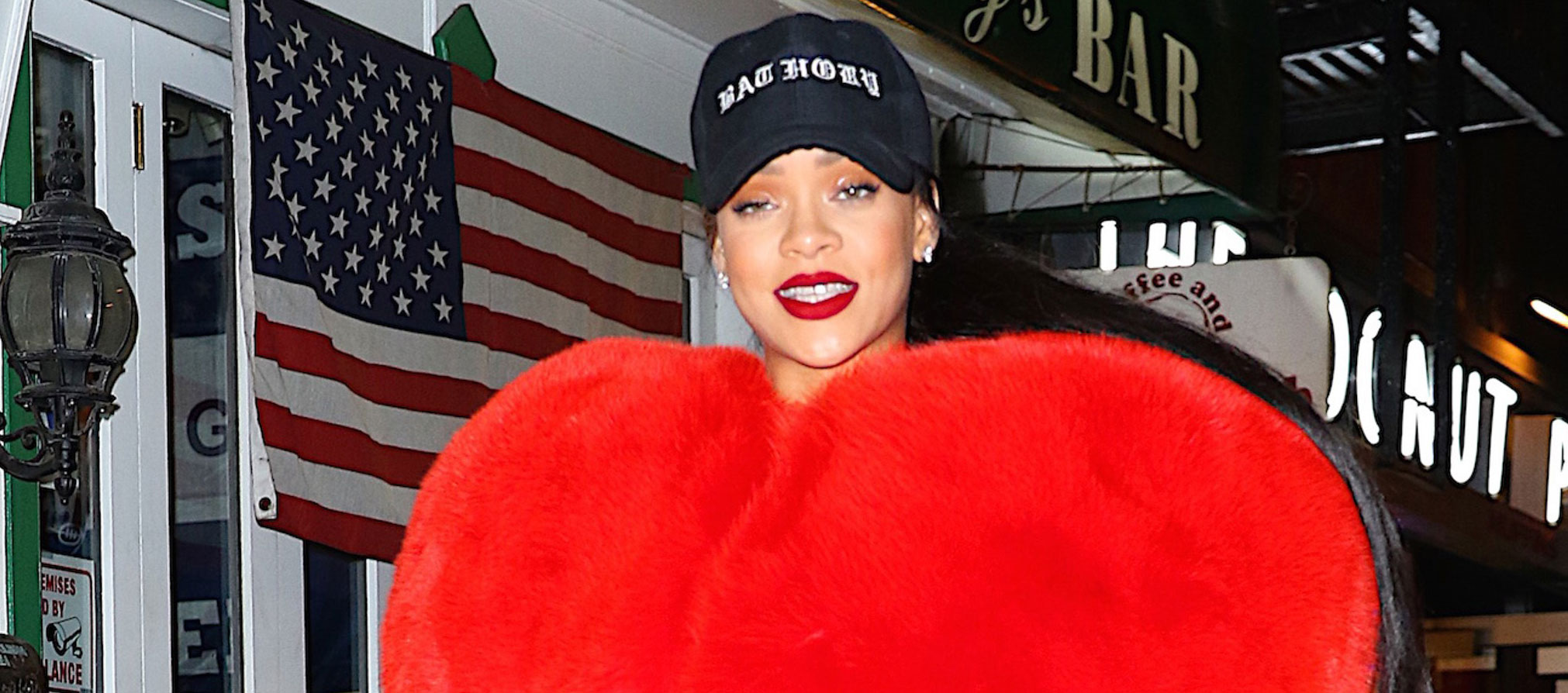 feabe2472e2 Rihanna Shows Off Her Love for NYC in Red Fur Heart Coat - Rihanna ...