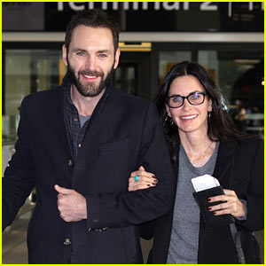 Courteney Cox is Joined by Johnny McDaid at Heathrow Airport