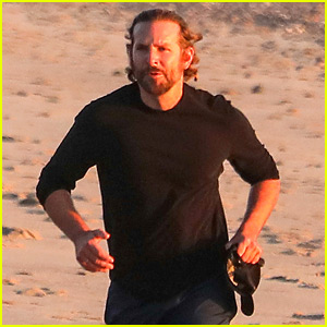 Dad-to-Be Bradley Cooper Goes for a Run on the Beach