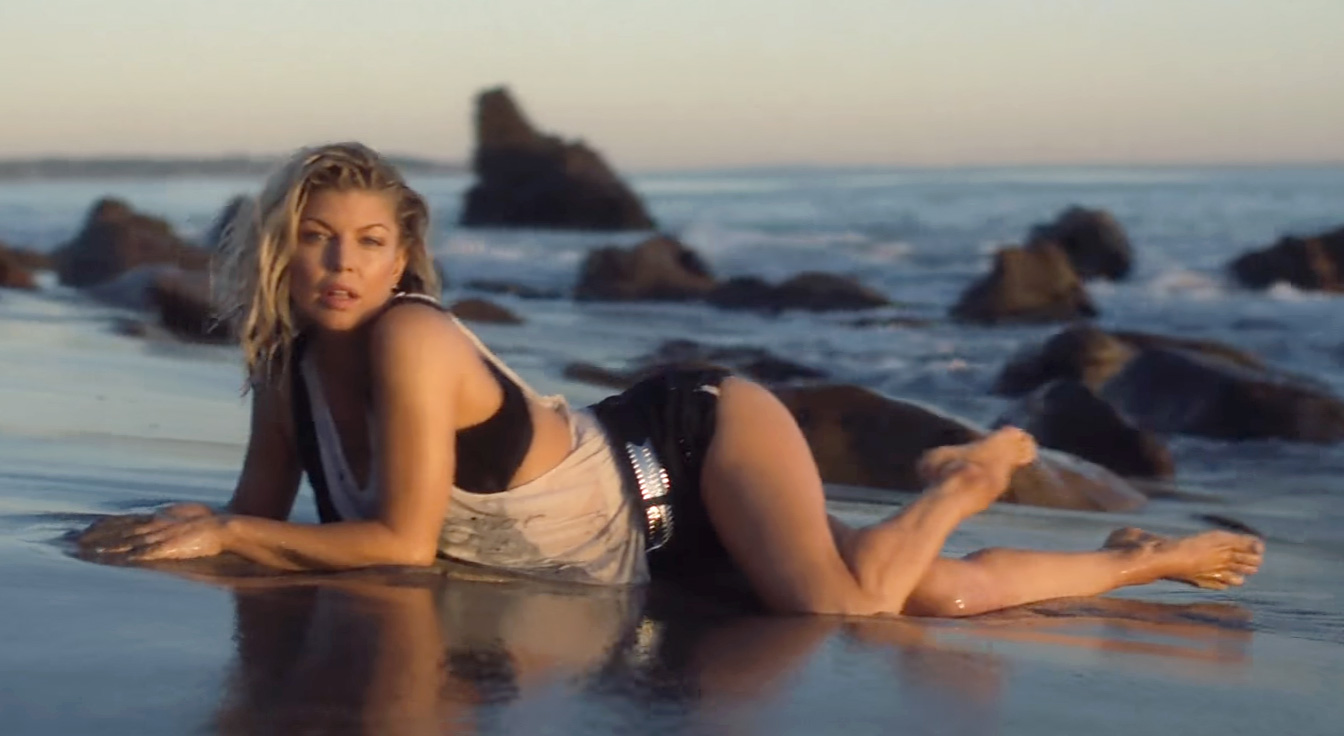 Fergie Rolls On The Beach In New Life Goes On Video
