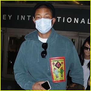 Pharrell Williams Wears Face Mask While Flying Into L.A.