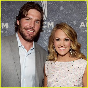 Carrie underwood sits on mike fisher s lap carrie for Carrie underwood husband mike fisher
